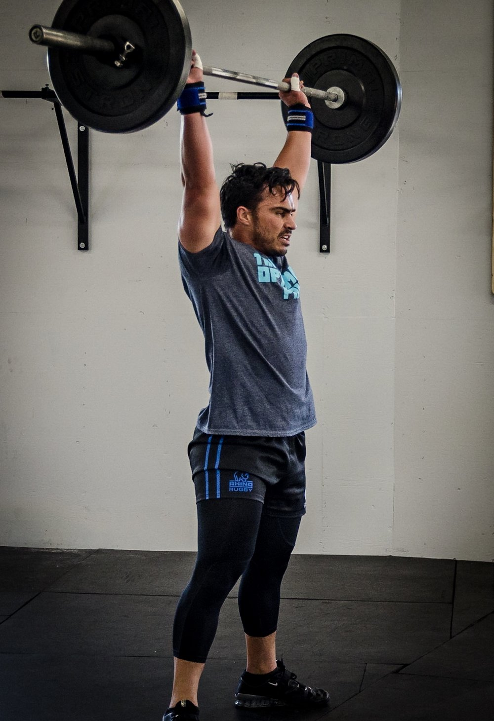 RAY - LCSW / Certified Strength and Conditioning Specialist / USA Powerlifting Club Coach / CrossFit Level OneRay was a collegiate, All-American and professional MLR rugby player. He started CrossFit as a way to stay in shape and maintain his competitive edge as he pursues his career as a mental health therapist. Ray also trains and competes as a powerlifter and loves strength based WODs. He is currently pursuing his second Master's degree, this time in Sports Conditioning and Performance from SUU. He enjoys singing, deadlifting, hiking, mountain biking, traveling with family, eating good food and body surfing. You might recognize him as the voice behind The Optimal Prime Podcast with Ray. Ray loves to coach because he is able to share and help other people experience the benefits of physical fitness. As a gym owner he is excited to build the best gym in Southern Utah in order to help his community with their fitness and life goals.