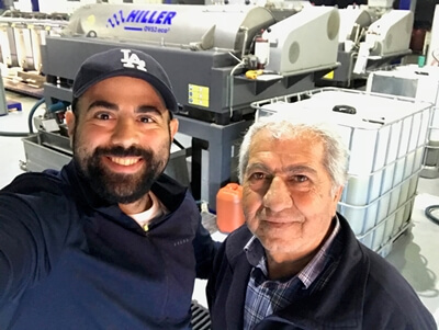 Hasan and his uncle at the mill, feeling relieved after successfully getting the olives there in the nick of time.