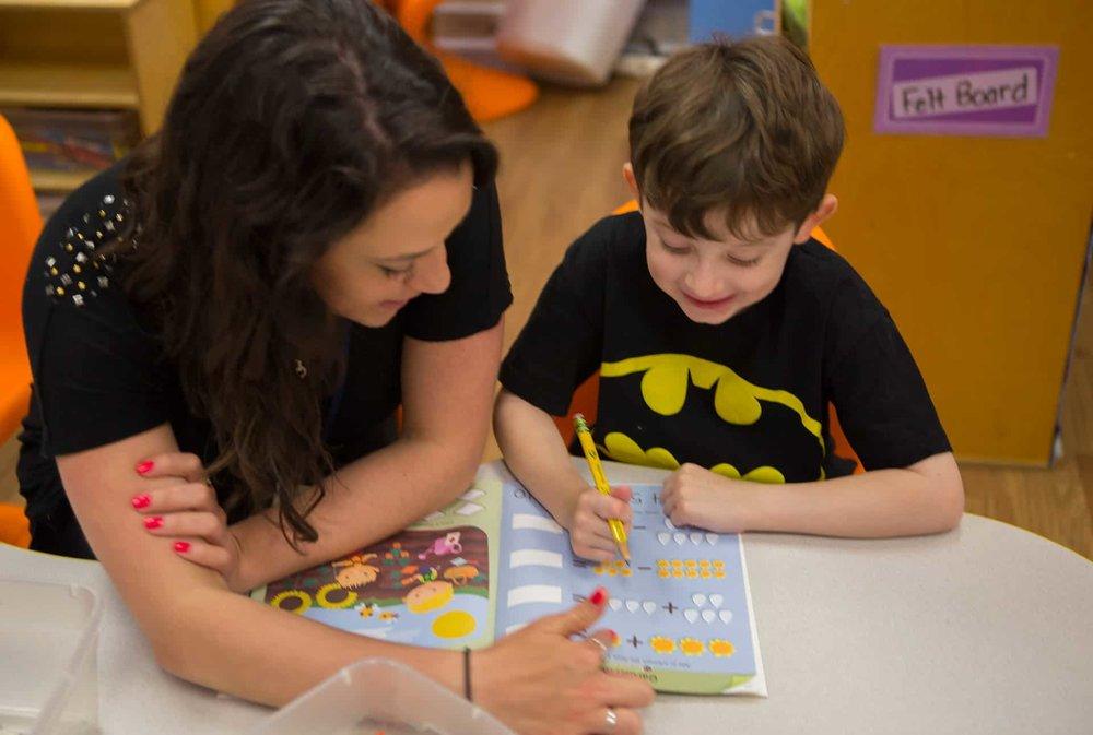 TSD_gallery_teacher_helping_child.jpg