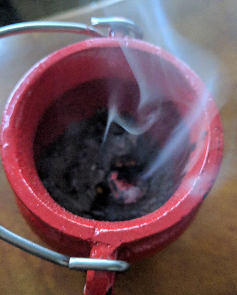 Burning of sacred smoke of Frankincense.