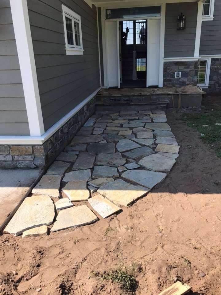 Flagstone Walkway by Ryan Tree & Landscape Service
