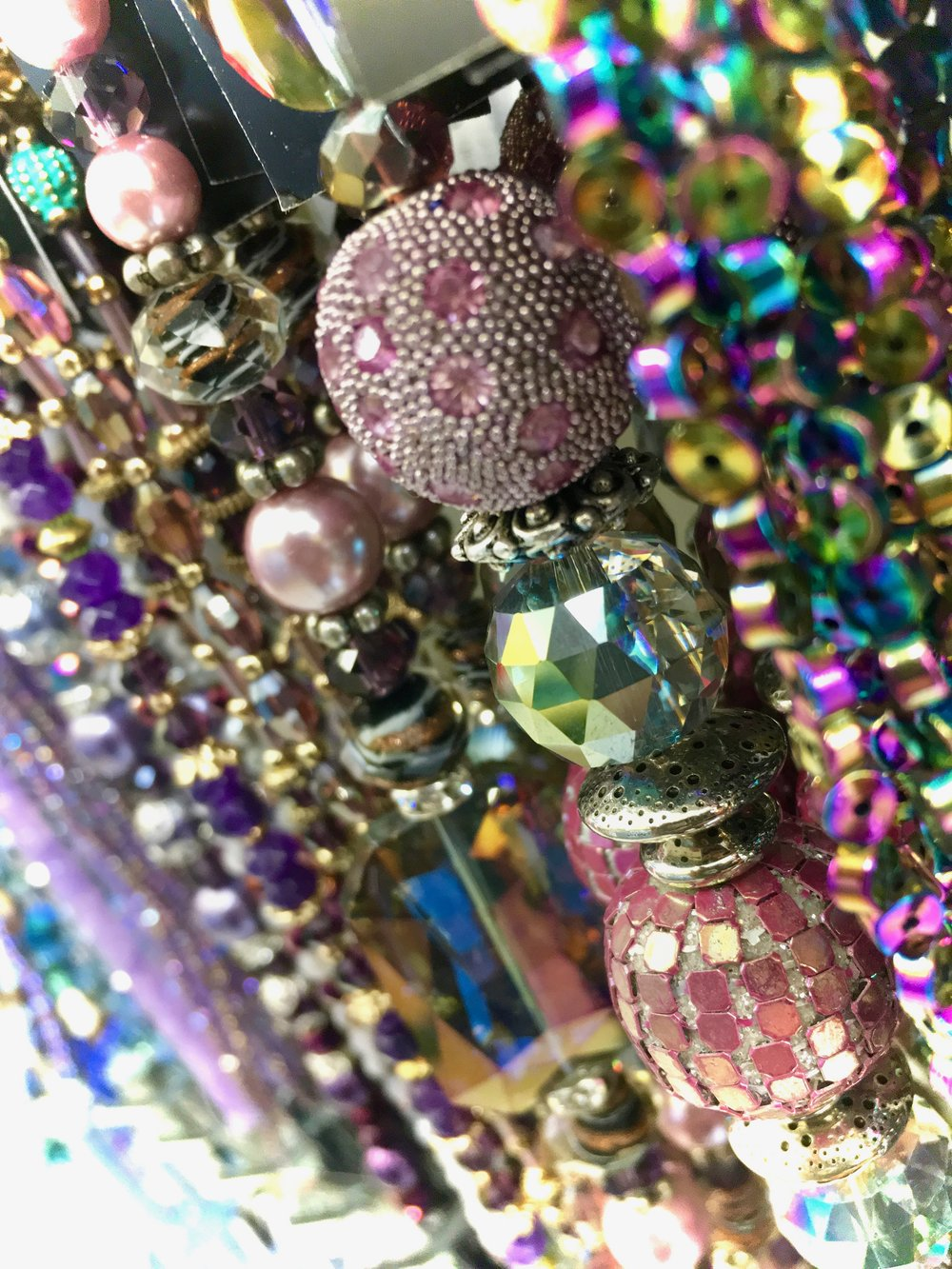 Twinkle, Twinkle - While running an errand for my Sunday school class, I saw this display of line after line of beads preening for the light, glittery in all their colors and shapes. Instead of buying one, I took the time to simply enjoy them ALL.