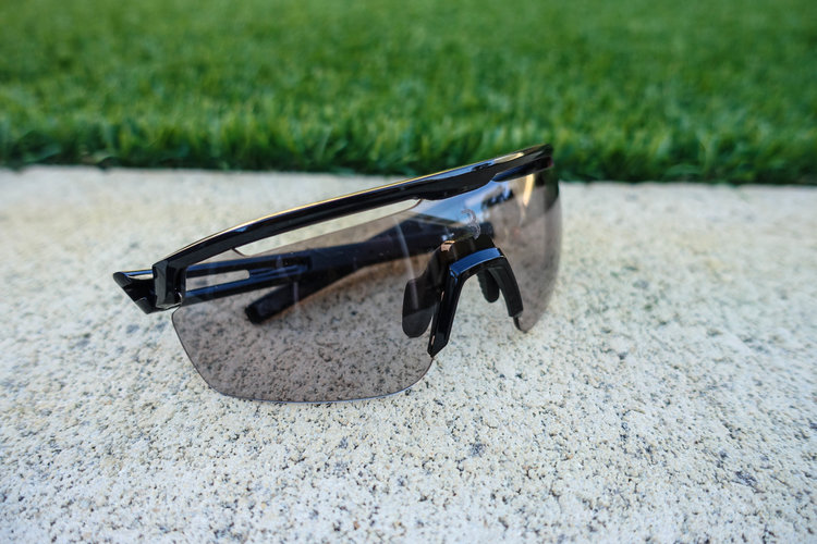 The Avenger model shown here in black, with the photochromic lens in a light tint amidst the afternoon shade.