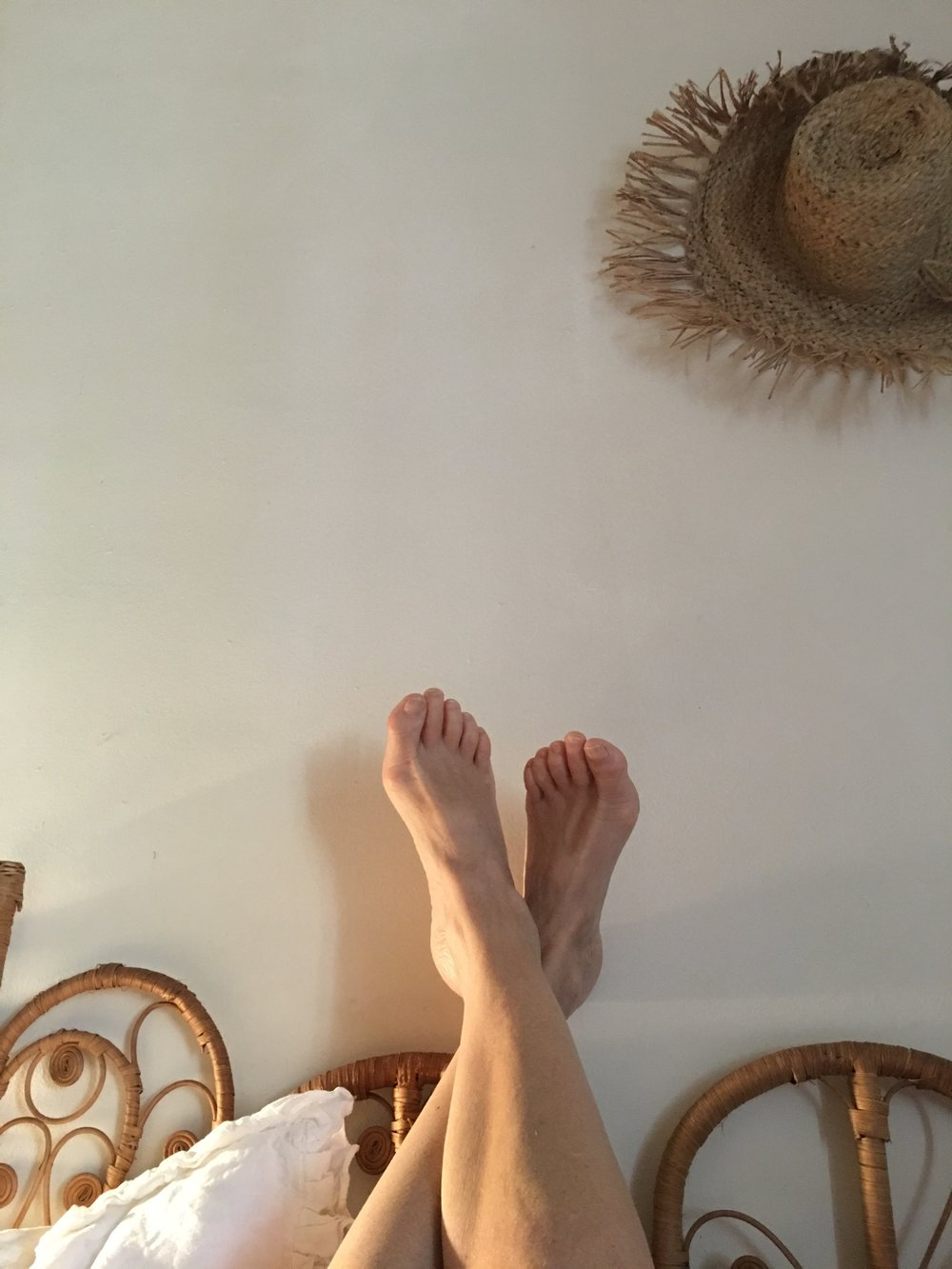 Lucinda's feet on the her bed