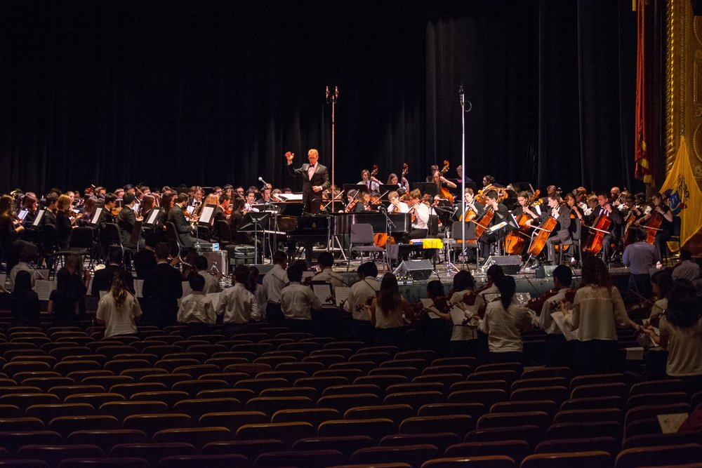 Maestro Robert Loughran preparing  Loughran's Lark  at the dress rehearsal for the Youth Orchestra of Bucks County's 25th anniversary gala.