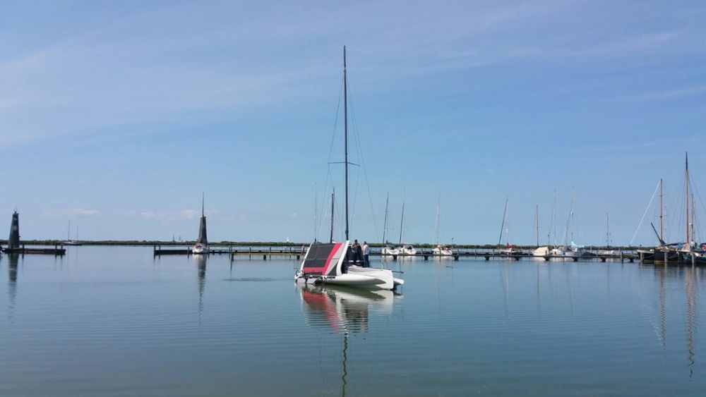 With the amas folded, the TF10 can be ramp or hoist launched and the foils inserted once in the water. Courtesy DNA Performance Sailing