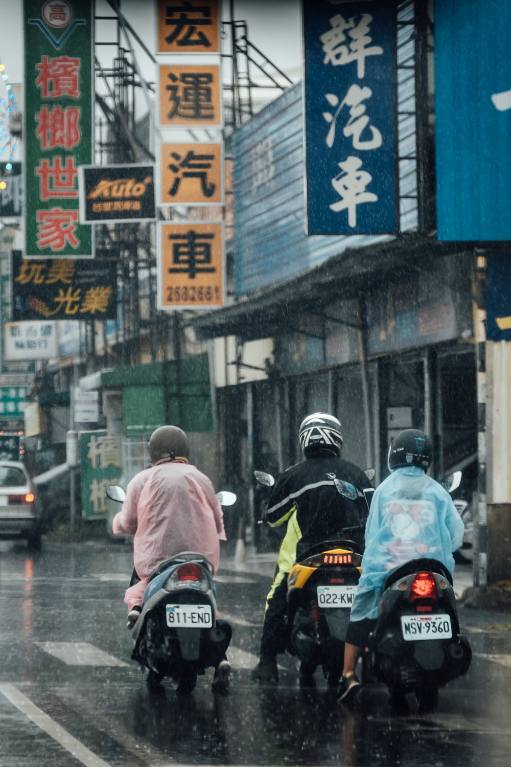 - Rain poncho + scooters are common sight on a rainy day