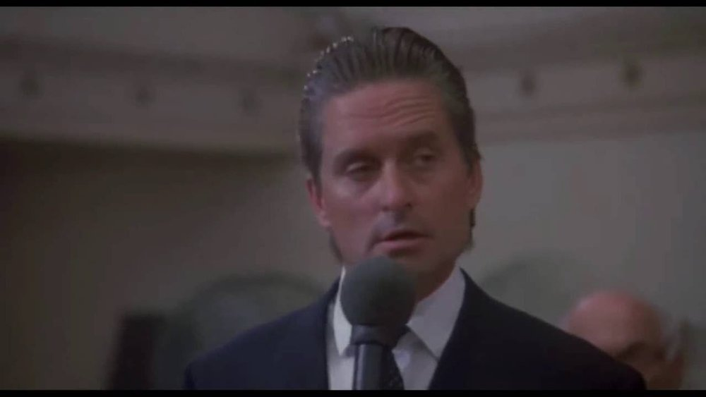 """""""Greed, for lack of a better term, is good."""" Michael Douglas as Gordon Gekko from the 1987 film  Wall Street ."""