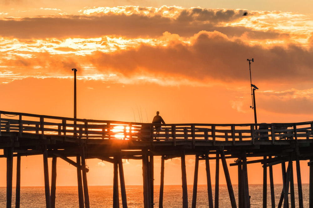 Orange sunset at the avon fishing pier outer banks North Carolina