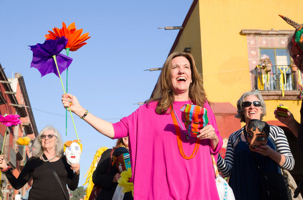 Lynn Whipple leads the parade in San Miguel