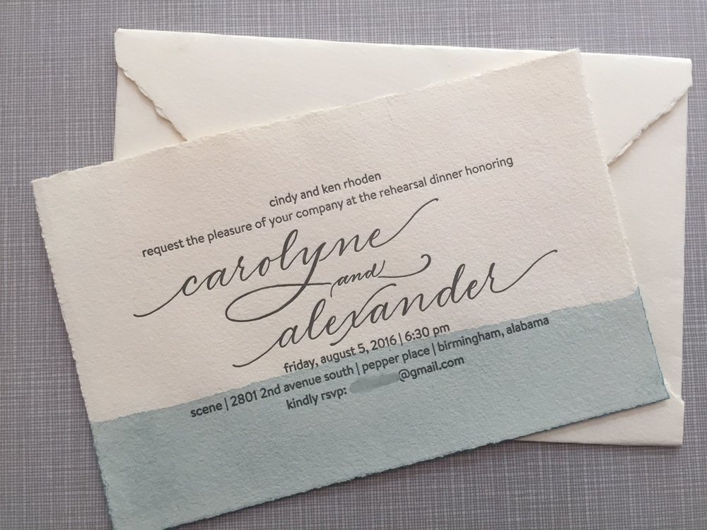 Hand-dipped watercolor invitations on spanish deckled edge paper, featuring hand calligraphy for names.