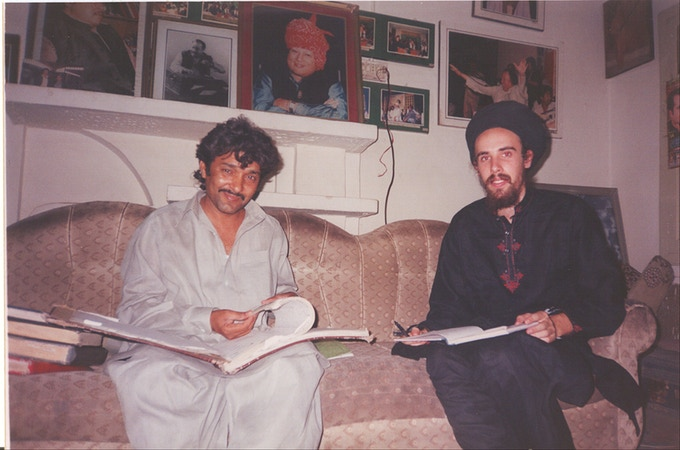 Translating & transliterating Ustad Nusrat Fateh Ali Khan's qawwali books with Ilyas Khan. 2003