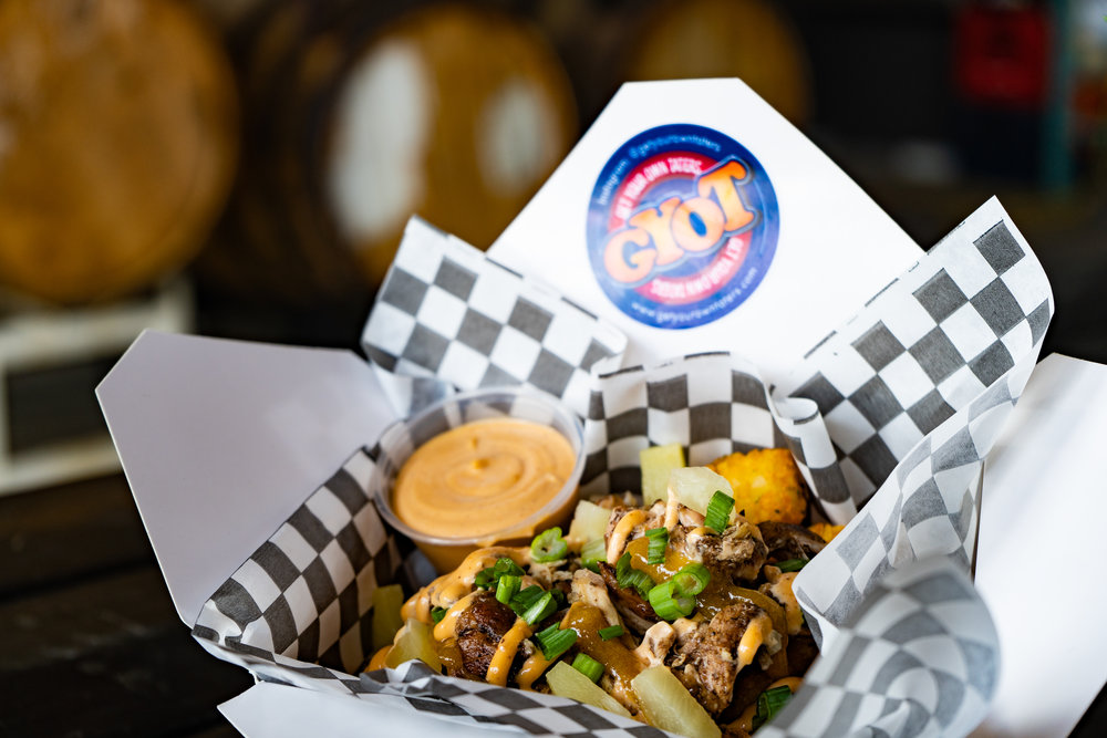 TOT-al Jerk - Jerk Chicken, pineapples, mango coulis and South Western chipotle mayo.