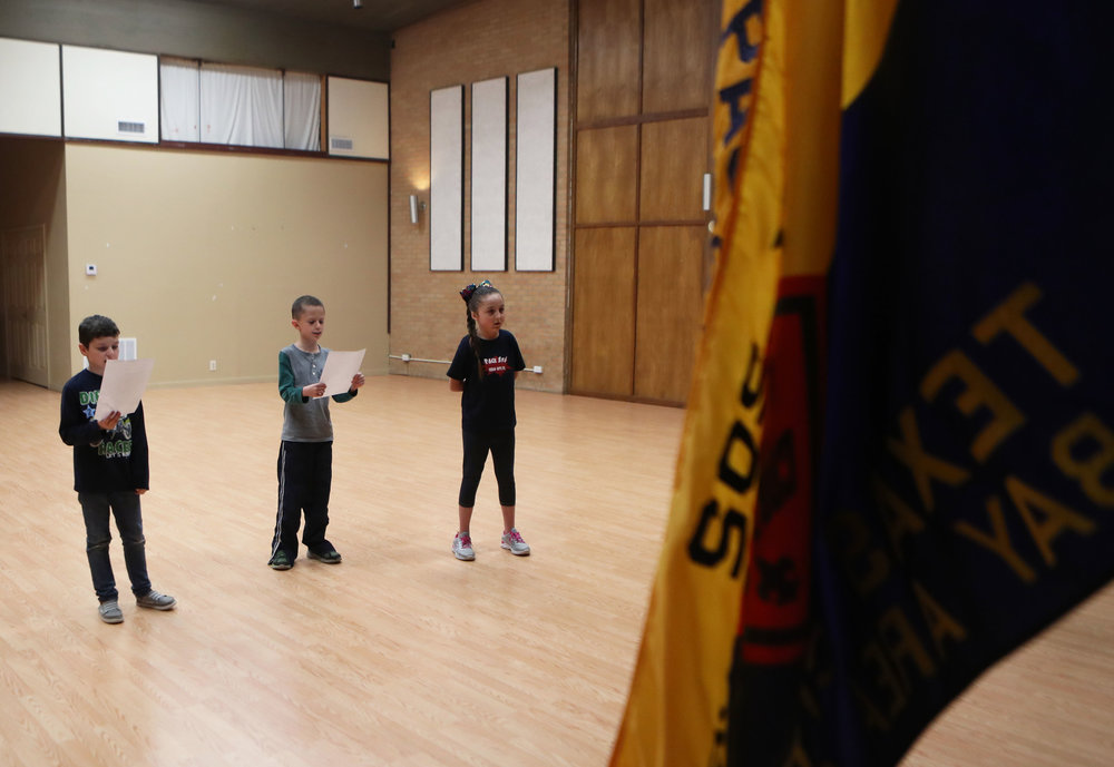 From left, J.T. Trumbature, Gavin Gutierrez and Vivica Northrup recite the Boy Scout Oath before their weekly den meeting at First Christian Church in Texas City on Monday, Nov. 19, 2018. Cub Scouts must memorize the oath before they can receive their first patch.
