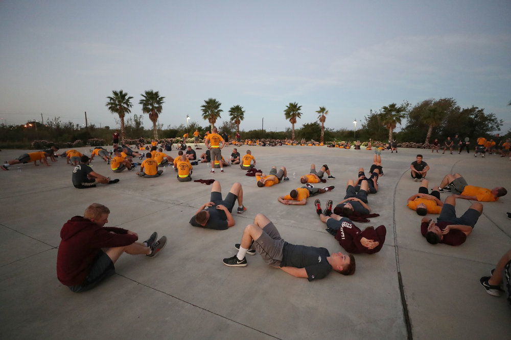 The Texas A&M University at Galveston Corps of Cadets work out during early morning PT on Wednesday, Nov. 15, 2017. The Corps of Cadets gathers at 0545 every Wednesday for a work out. Although some cadets have to participate in the corps as a requirement for their major, 80% will come out of the corps and go into service, whether that be navy or merchant marines.