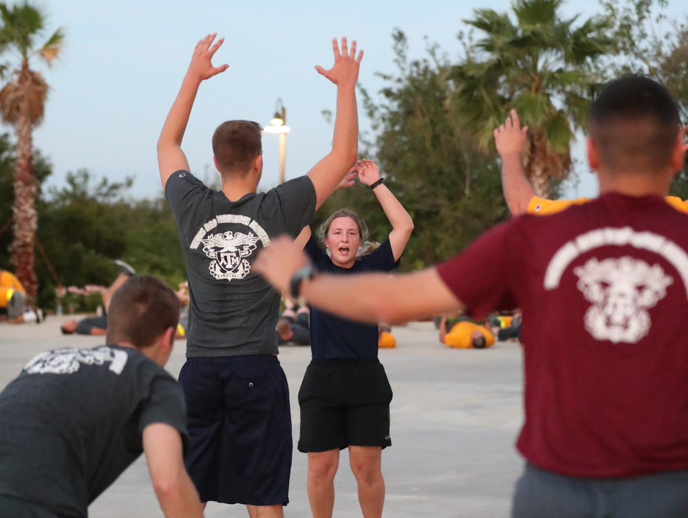 Cadet Madeleine Salmon leads an exercise during early morning PT on Wednesday, Nov. 15, 2017. Properly managing time, learning to balance life and multitasking are talents cadets must master in the program. Cadets must not be unaccounted for and need to follow schedule at all times while keeping good grades.