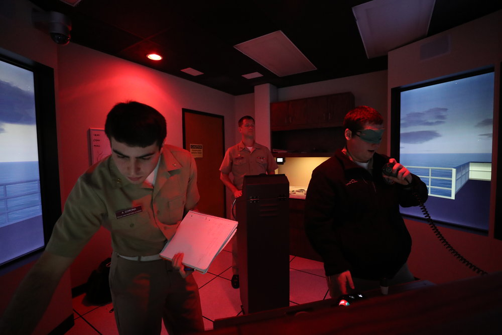 From left, Cadet Avery Corona, Cadet Jack Stencil and Cadet James Winkle make sure they are headed in the right direction during a simulation for their capstone class on Wednesday, Nov. 29, 2017. As a challenge, Capt. Putty blindfolded a team member and shut off the ship's GPS.