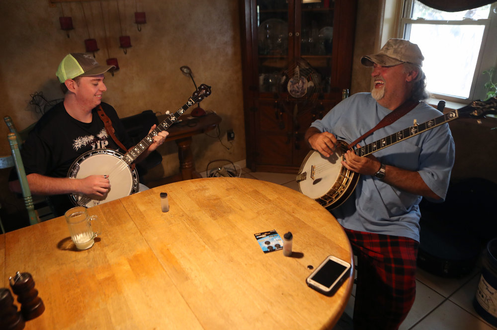 """Elias enjoys learning a tune from banjo teacher Alan Strickland in West Plains. Strickland, who had not played in many years, was inspired by Elias to pick up his banjo again. """"Elias is like a sponge with the banjo,"""" Alan said. """"I'm going to miss my buddy."""""""
