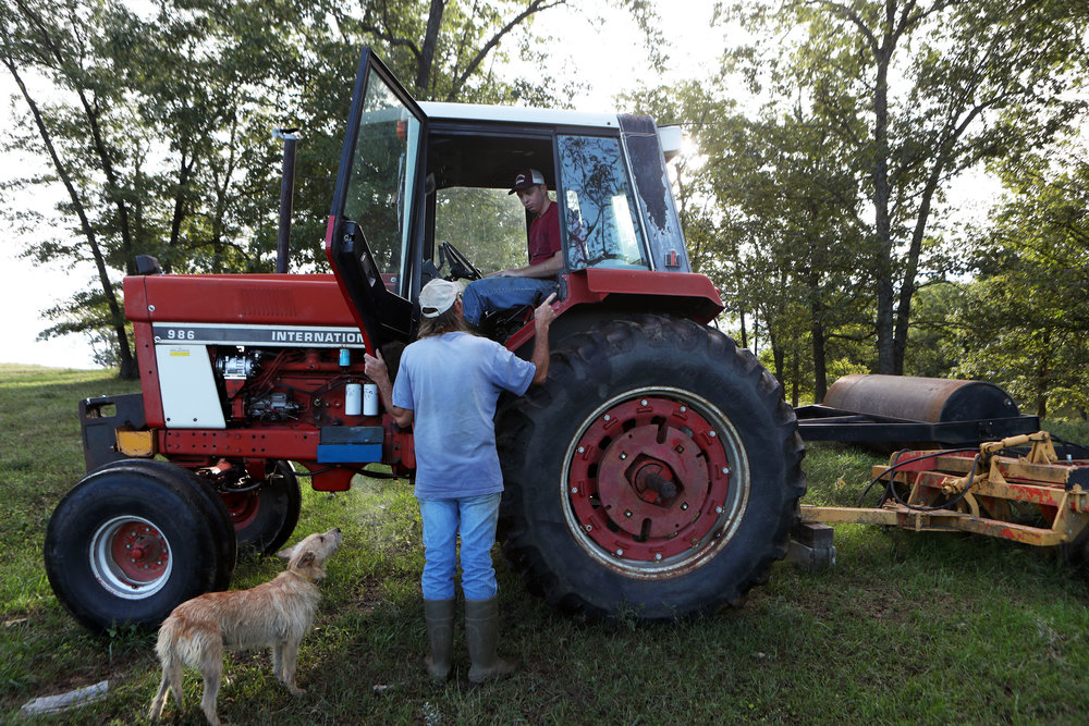 Elias consults with his dad as they try to hook an implement to the tractor. Elias has been Eric's right-hand man since he was a child. Eric planned to drive with Elias to Kansas City, but decided to stay back because it would be too emotional for him.