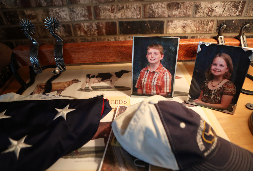 Besides homemade spurs and a flag that flies on special occasions, pictures of Elias and his sister Hala are on display on a dresser at home.