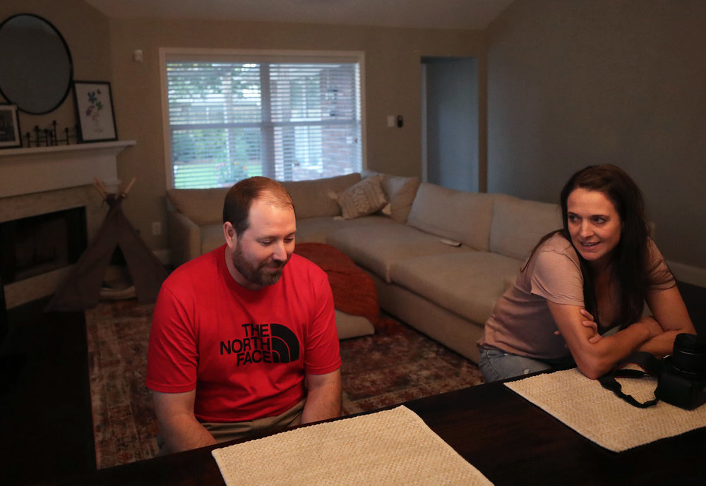 Jimmy and Tiffany Bishop talk about their day at the dining room table in their newly renovated house on Wednesday, July 25, 2018. Hurricane Harvey deeply affected the Bishops' lives; however, they used the experience to better their lives. They have all the insurance they need, preparation plans, an idea of what it takes to get through a hurricane and a closer bond as a family.