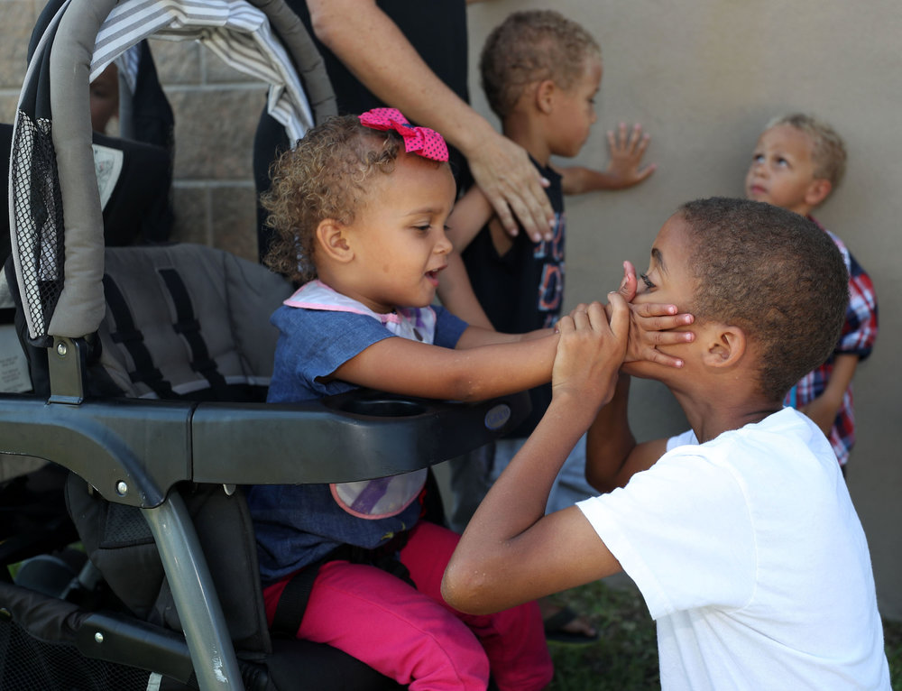 Kendra and Kishon White play together while on a walk to the Galveston Children's Museum on Wednesday, May 16, 2018. The White siblings are each other's playmates as well as siblings and love spending time together.