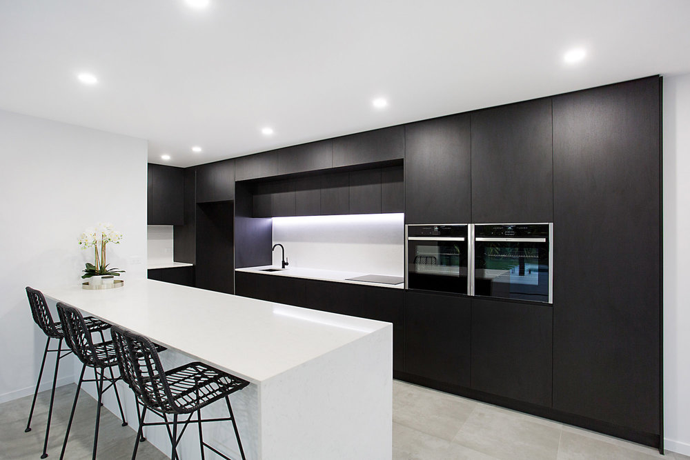 Modern luxury black kitchen with marble bench tops - Gold Coast Building and Renovations