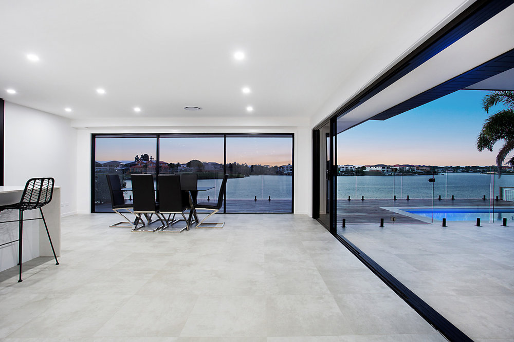 modern indoor outdoor living spaces, using the same tile internally and externally seamlessly flows