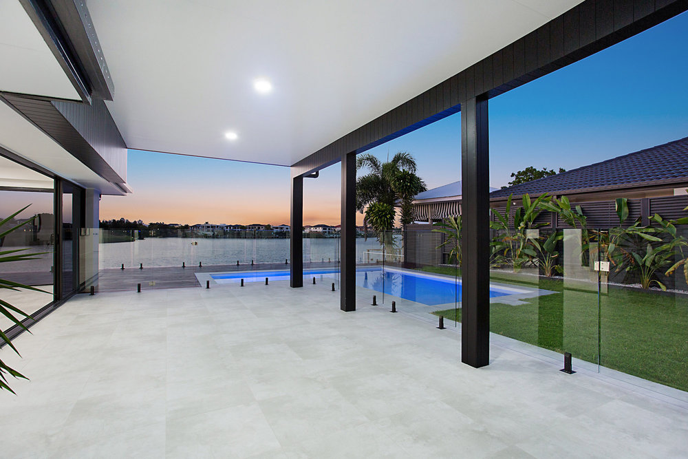 modern patio with black cladding, luxury outdoor living space