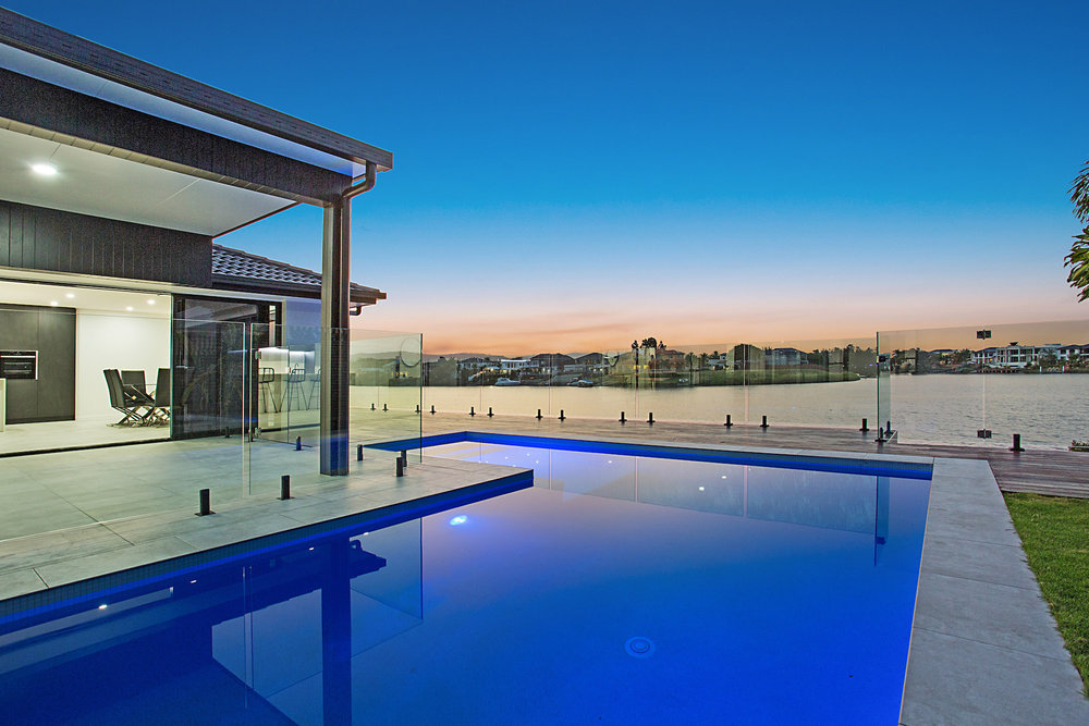 modern waterfront pool with white mosaics