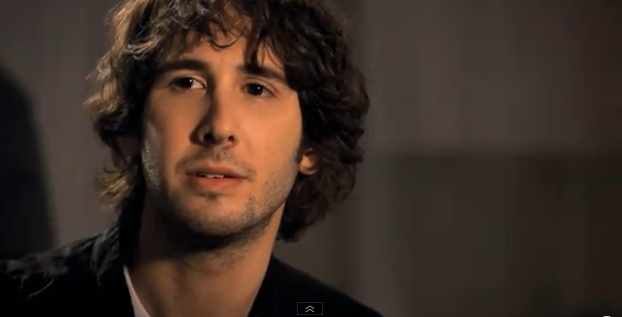 A screencap from the video for Hidden Away, where Josh Groban looks all smouldery and emo.