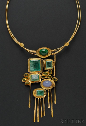 Ancient-looking geometric multi-stone pendant on a round gold necklace base.