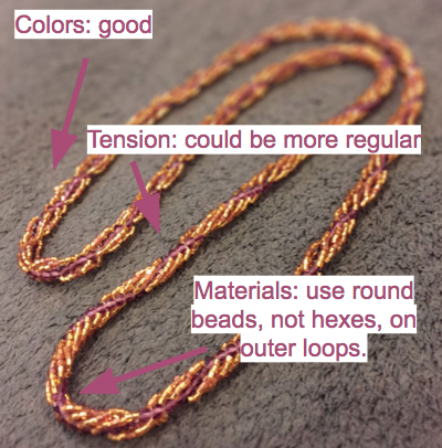Spiral rope necklace with critique text.