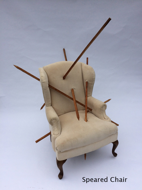 Speared Chair - This is another static piece designed to be shown in a gallery setting. It also consists of an old easy chair upholstered with worn ivory velvet. The body of the chair is pierced by long wood spears in numerous places. Among other images, the chair's distress recalls the martyrdom of Saint Sebastian, a favorite subject of Renaissance painters.