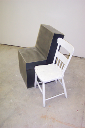 Two Chairs - This sculpture comments on the history of design, and the difference between a functional utilitarian object, and a nonfunctional poetic object. In this piece the classic wooden kitchen chair is used as a template for a contemporary sleek steel chair.Material: Welded Steel and wood chairDimensions: 3' height
