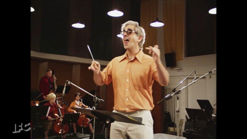 Conducting onscreen in IFC's Documentary Now ( Original Cast Album: Co-op )