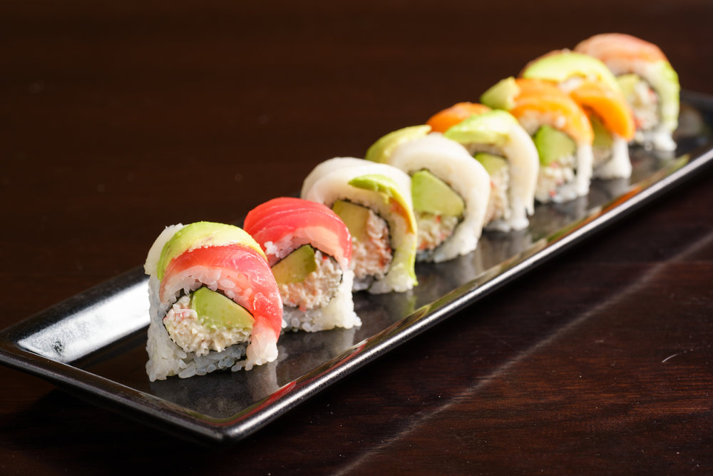 Snow Crab and Avocado Roll Topped with Assorted Fishes