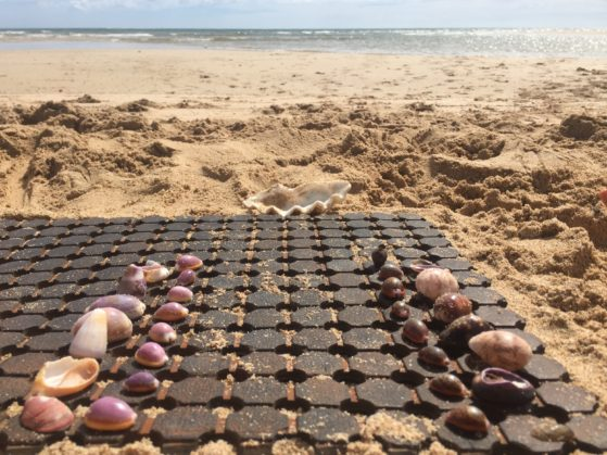 Holiday activities: Beach chess made from shells and a bath mat