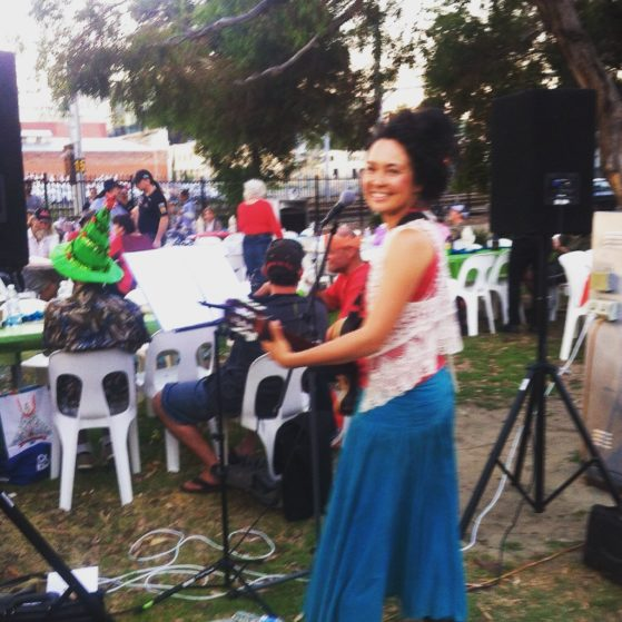 Action shot- singing at a Christmas dinner for the homeless in Perth City