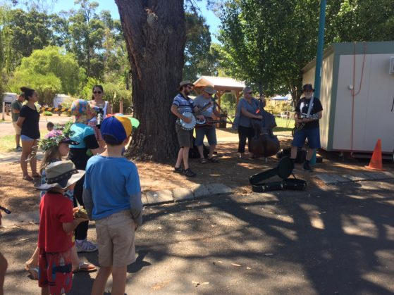 Kale watching musicians busk at Nannup music festival