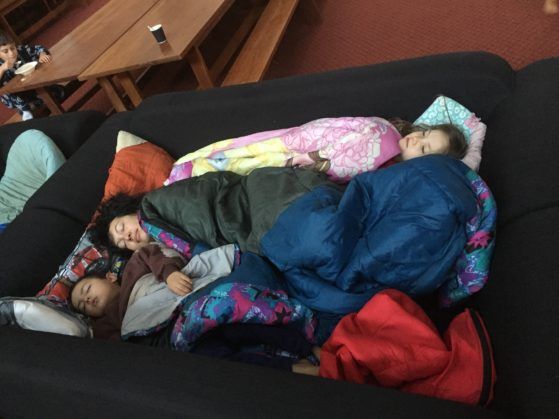 Homeless: The younger kids wanted to sleep indoors so I joined two couches together to make us a bed in Prindiville Hall