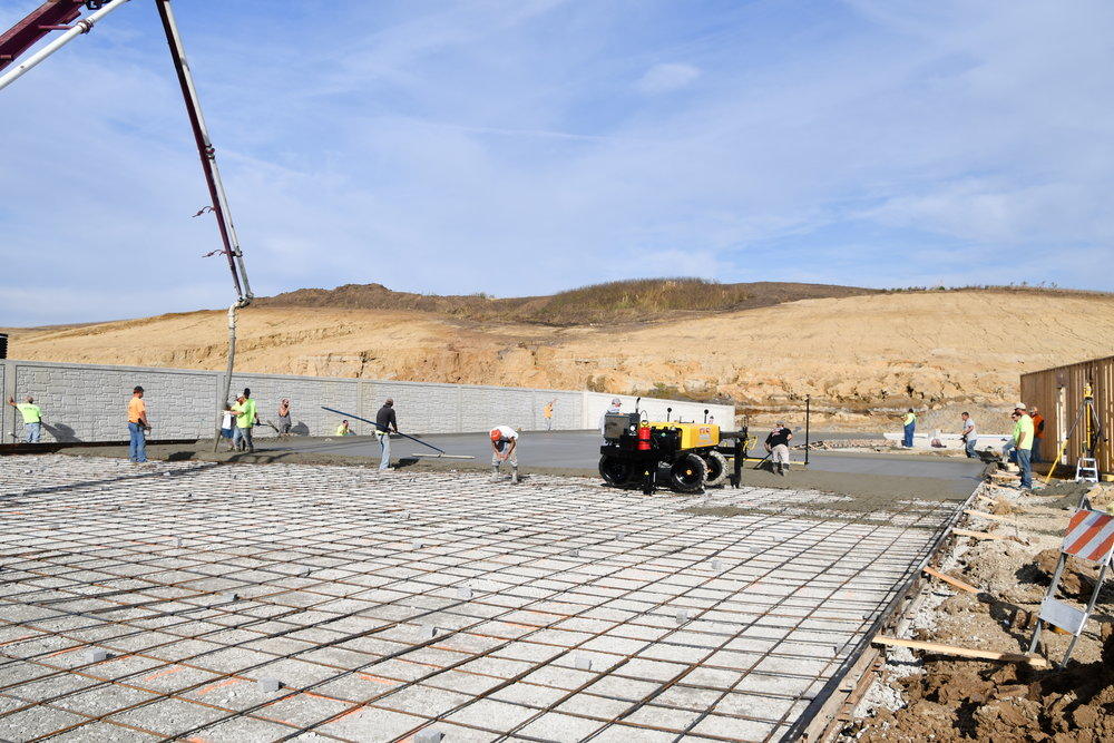 Pumping and laser screeding a 400 yard pavement section