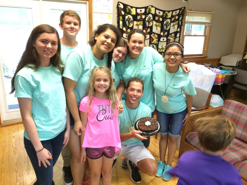 Immersion Island campers showing off their baking skills