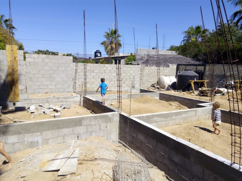 child walking on house in construction