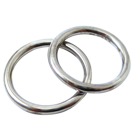 2.5mm round wire wedding rings.jpeg