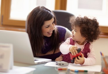 woman with laptop and child
