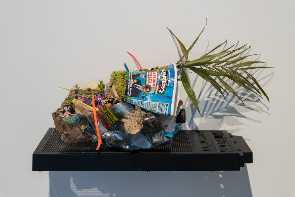 B-612 , 2018  Various items consumed by artist with friends in their bedroom on computer housing as shelf