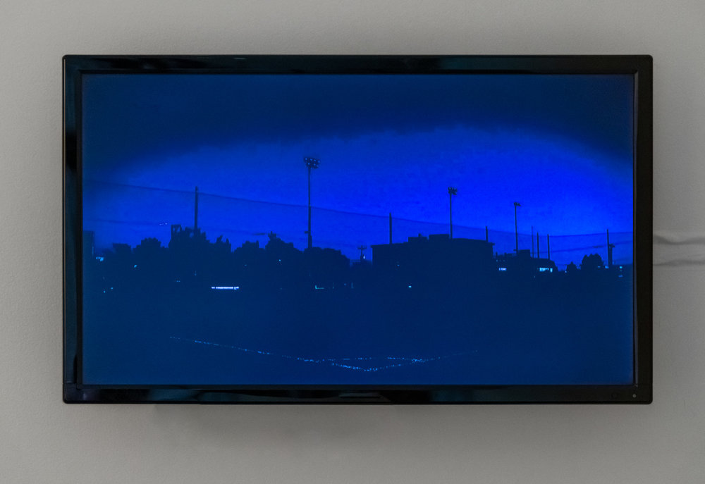 Dan Paz. Credits , 2019; video; installation view, The sun never knew how great it was until it struck the side of a building ,HOLDING Contemporary.Courtesy of HOLDING Contemporary, Portland. Photo: Mario Gallucci.