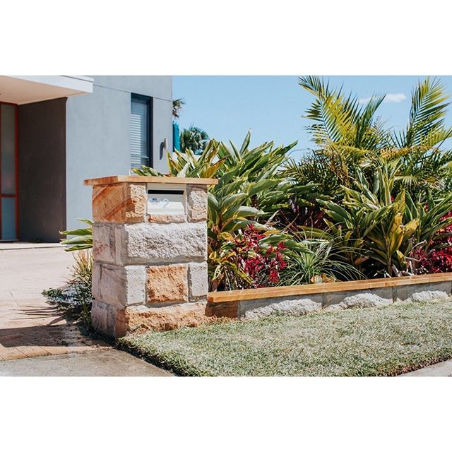 Let's get tropical!!! #sandstone #garden #landscaping #modern #palms #cordyline #bromeliad #pebble