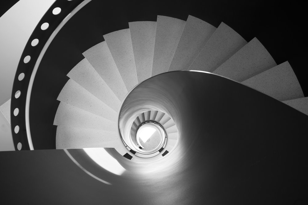 SWEDISH FILM INSTITUTE - Black and White filmstrip shaped helical staircase in Filmhuset, Stockholm, Sweden.